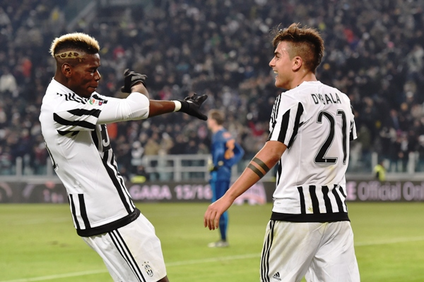 Paulo Dybala (right) of Juventus FC celebrates after scoring against Roma with team mate Paul Pogba