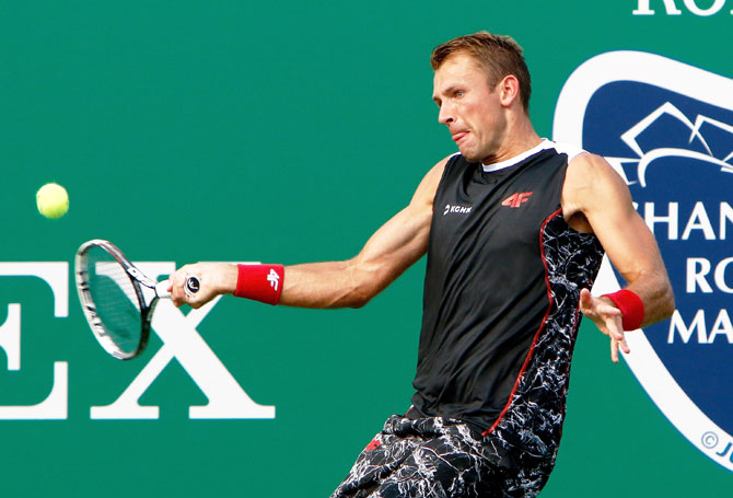 Poland's Lukasz Kubot returns a shot