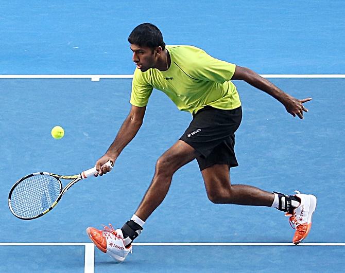 Rediff Sports - Cricket, Indian hockey, Tennis, Football, Chess, Golf - Bopanna-Cuevas knocked out by Djokovic-Troicki