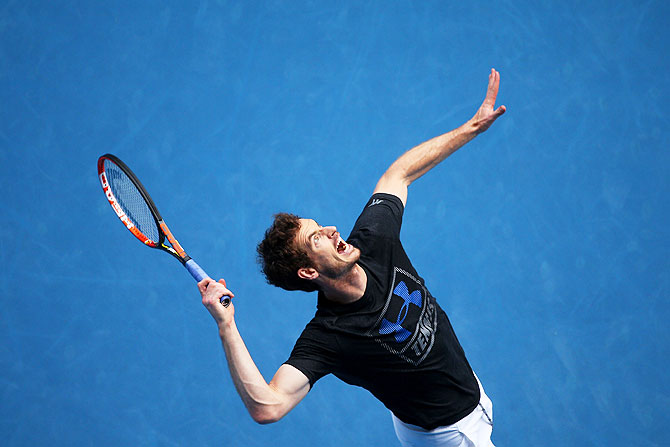 Andy Murray of Great Britain serves in a practice session on Saturday