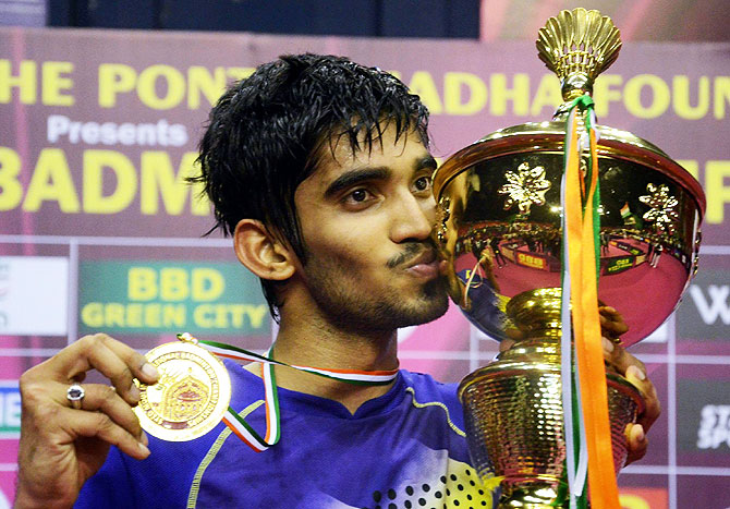 Indian shuttler K. Srikanth with Syed Modi grand prix trophy after beating Chinese player Huang Yuxiang in Lucknow on Sunday