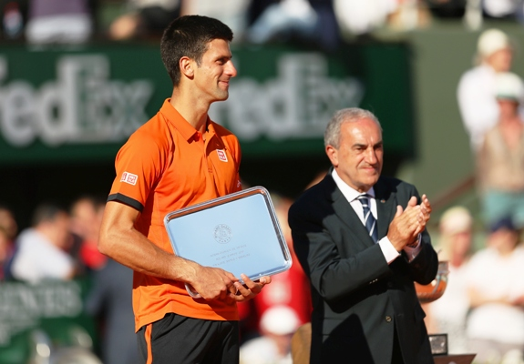 Novak Djokovic of Serbia holds the runners up trophy