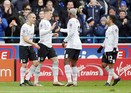 Everton's Ross Barkley (2nd from left) celebrates after he scores his sides third goal against Carlisle United during the Emirates FA Cup Fourth Round match at Brunton Park in Carlisle on Sunday
