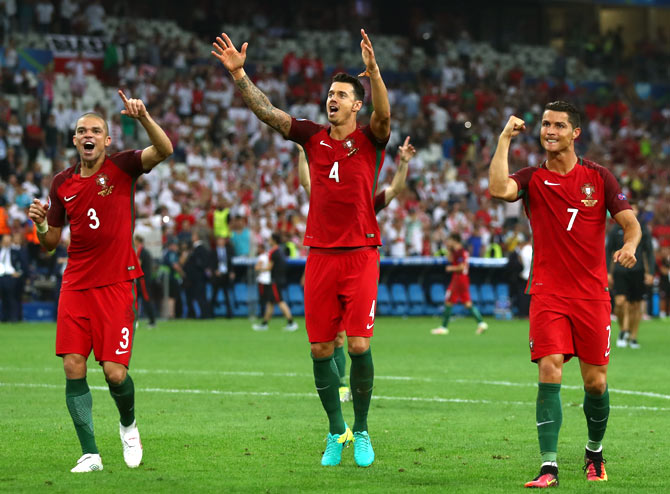 Pepe, Jose Fonte and Cristiano Ronaldo of Portugal celebrate their team's win