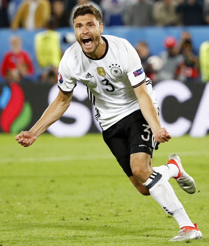 Germany's Jonas Hector celebrates scoring in the penalty shootout against Italy