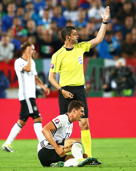 Germany's Mario Gomez lies injured during their Euro 2016 quarter-final match against Italy at Stade Matmut Atlantique in Bordeaux on Saturday