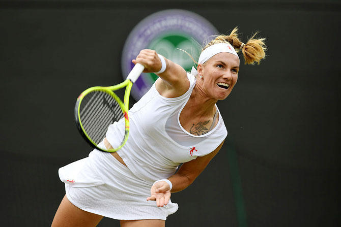 Russia's Svetlana Kuznetsova serves during her third round match against USA's Sloane Stephens on Middle Sunday
