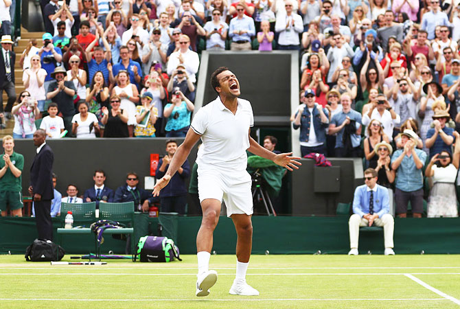 Jo-Wilfried Tsonga of France celebrates his third round victory over the USA's John Isner on Middle Sunday