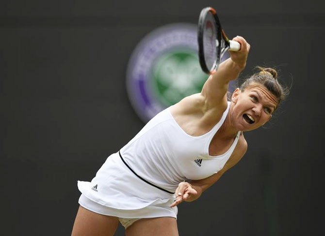 Romania's Simona Halep serves in her match against USA's Madison Keys