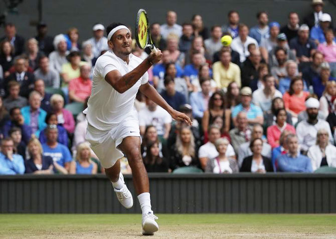 Australia's Nick Kyrgios in action against Great Britain's Andy Murray