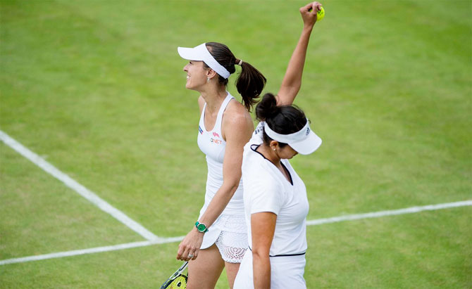 Martina Hingis and Sania Mirza celebrate their win