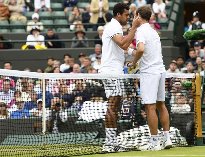 France's Richard Gasquet talks with France's Jo-Wilfried Tsonga as he retires from their match due to injury