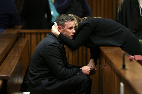 : Oscar Pistorius is seen with sister Aimee after proceedings of his resentencing hearing