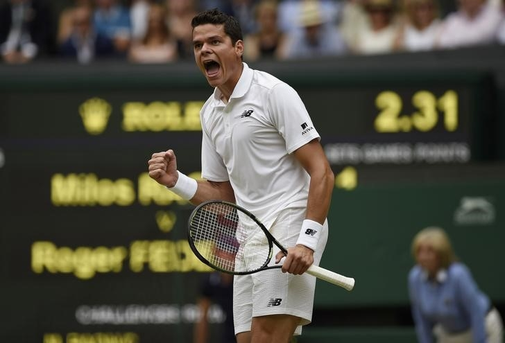 Canada's Milos Raonic celebrates after beating Roger Federer