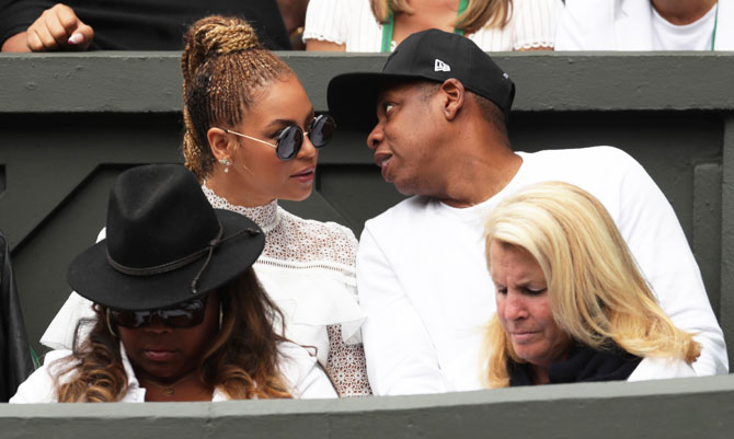 Singer Beyonce with her husband musician Jay Z with Serena Williams's family and friends in the Royal Box on centre court during the women's singles final on Saturday
