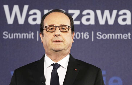 French President Francois Hollande speaks during a news conference at the NATO Summit in Warsaw, Poland, on Saturday