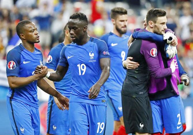France's Bacary Sagna (centre), Patrice Evra and Hugo Lloris celebrate a win