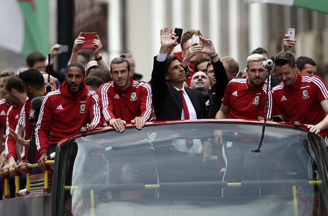 Rediff Sports - Cricket, Indian hockey, Tennis, Football, Chess, Golf - Wales welcomed home by hundreds of thousands of fans