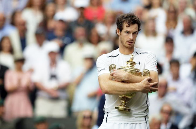 Great Britain's Andy Murray celebrates winning the men's singles final against Canada's Milos Raonic with the trophy