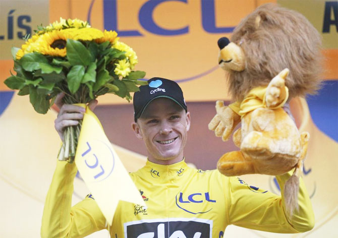 Yellow jersey leader Team Sky rider Chris Froome of Britain reacts on the podium