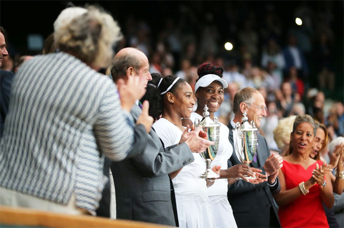 Williams sisters lift Wimbledon doubles title