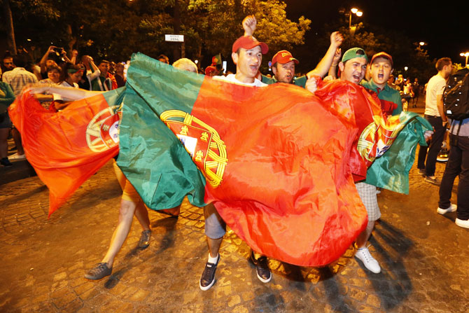 Rediff Sports - Cricket, Indian hockey, Tennis, Football, Chess, Golf - Jubilant Portugal fans hit the streets after Euro triumph