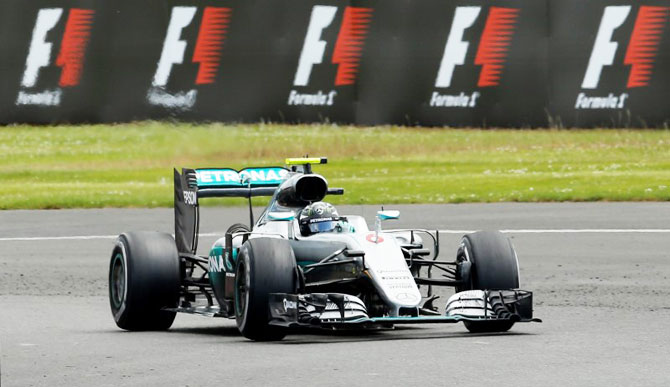 Rediff Sports - Cricket, Indian hockey, Tennis, Football, Chess, Golf - Rosberg handed time penalty, loses second place