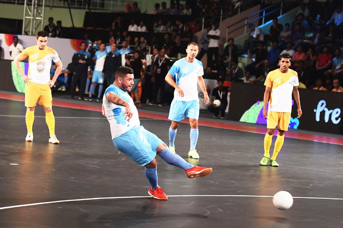 Mumbai 5's futsal player Adriano Foglia scores against Chennai 5's during their Premier Futsal match at Nehru Indoor Stadium in Chennai on Friday