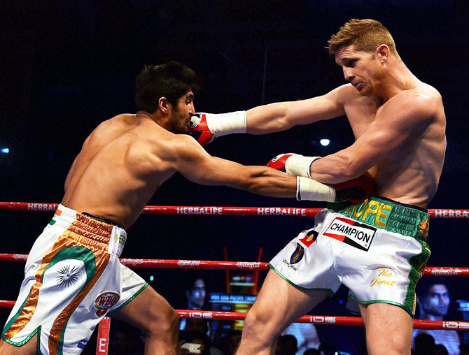Boxer Vijender Singh lands a punch on opponent Kerry Hope during their WBO Asia Pacific Middleweight Championship at Thyagaraj Sports Complex in New Delhi on Saturday