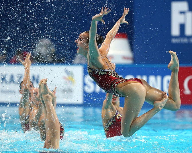 The Russia team compete in the Women's Free Combination Synchronised Swimming Final