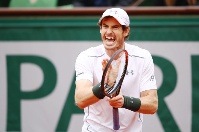 Britain's Andy Murray reacts during his French Open quarter-final match against Frenchman Richard Gasquet at Roland Garros in Paris on Wednesday