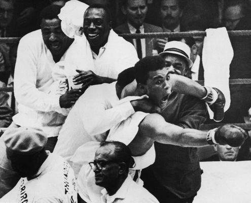 Muhammad Ali flies around the ring after beating Sonny Liston in the seventh round of the World Heavyweight Title bout in Miami Beach. It was during these scenes that he claimed, 'I am the Greatest' and 'I shook up the World'
