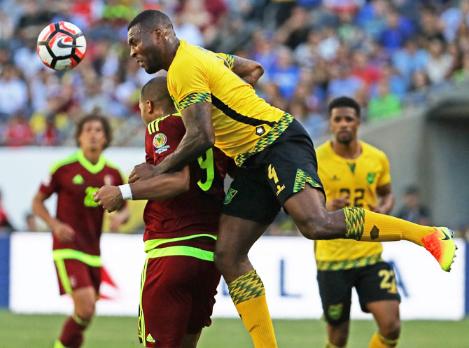 Jamaica's Wes Morgan heads the ball over Venezuela's Jose Salomon Rondon