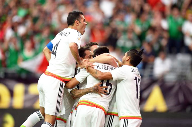Mexico players celebrate a goal by midfielder Hector Herrera (16) during their Copa America Centenario match against Uruguay in their Group C match at University of Phoenix Stadium in Glendale, Arizona. on Sunday