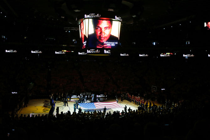 A moment of silence is held for the passing of Muhammad Ali prior to Game 2 of the 2016 NBA Finals between the Golden State Warriors and the Cleveland Cavaliers at ORACLE Arena in Oakland, California, on Sunday