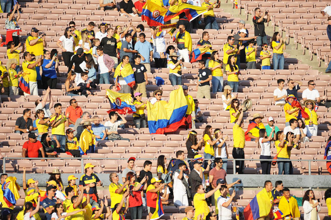 Colombia fans in attendance cheer before the group game against Paraguay at the 2016 Copa America Centenario at Rose Bowl Stadium in Pasadena on Monday. Reports have suggested that the US-hosted tournament is not drawing too many fans to the stadium