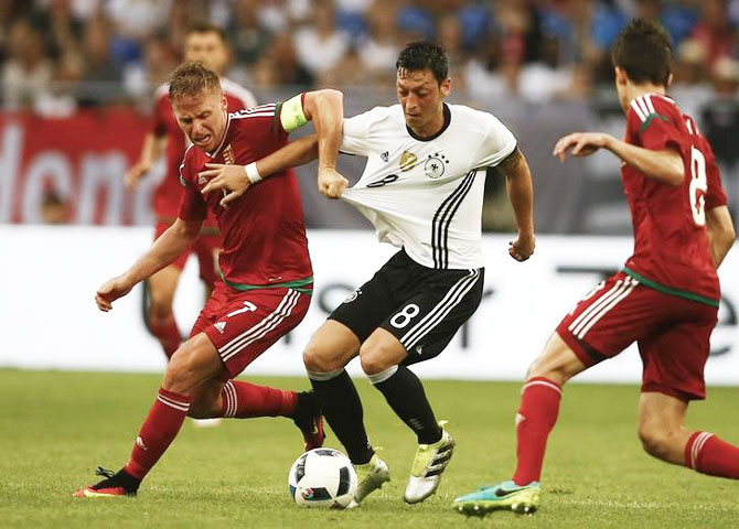 Germany's Mesut Oezil and Hungary's Balasz Dzsudszak vie for possession during their international friendly on Saturday. Expectations are high that Ozil will come good and help the German to the Euro title this year