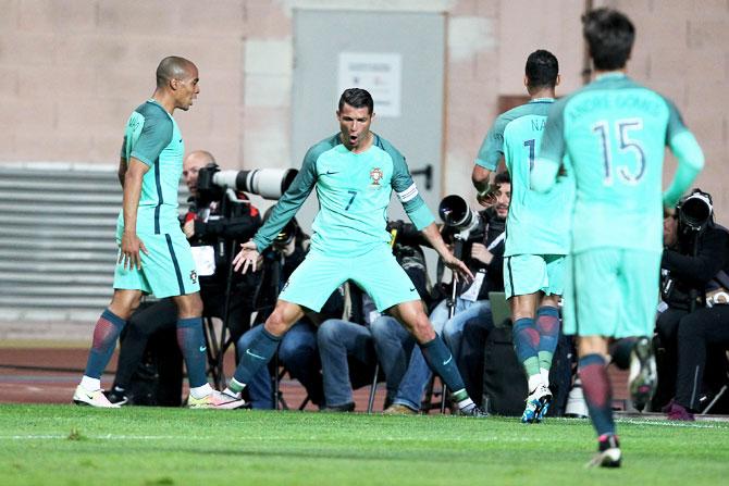 Portuguese's forward Cristiano Ronaldo celebrates scoring Portugal's goal