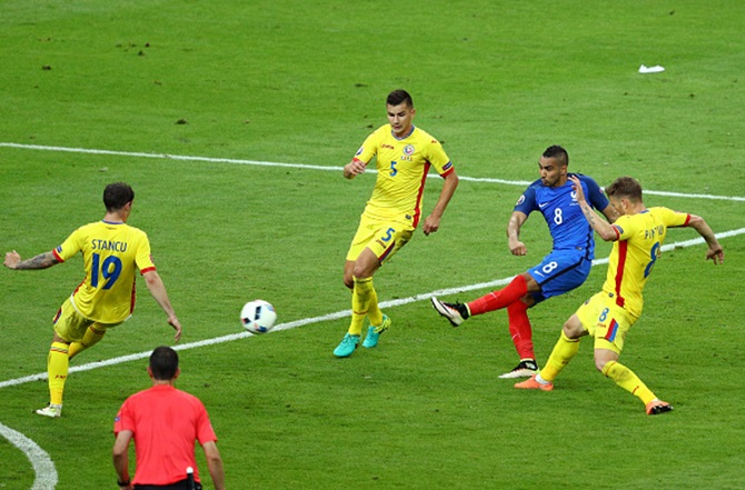 IMAGE: France's Dimitri Payet scores his team's second goal against Romania in the opening game of Euro 2016 in Paris, June 11, 2016. Photograph: Paul Gilham/Getty Images