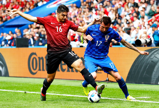 Turkey's Ozan Tufan and Croatia's Mario Mandzukic vie for possession during their Euro 2016 match on Sunday