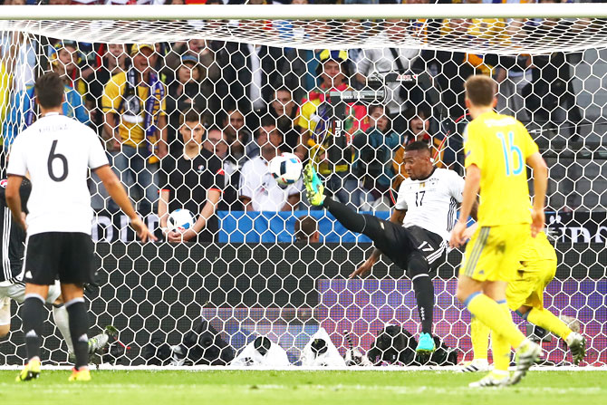 Germany's Jerome Boateng clears the ball off the goal line to deny Ukraine on Sunday