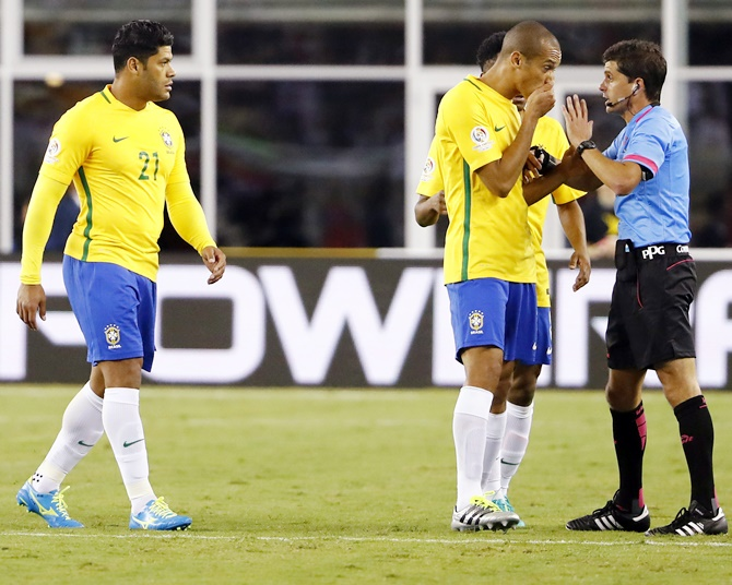 Brazil defender Miranda, centre, talks with referee Andres Cunha after he allowed the only goal of the game