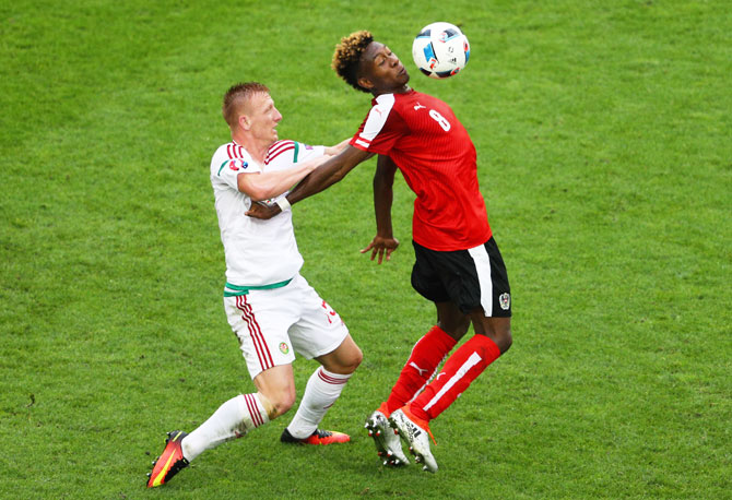 Austria's David Alaba (right) controls the ball as he is challenged by Hungary's Laszlo Kleinheisler  during their Euro 2016 Group F match at Stade Matmut Atlantique in Bordeaux on Tuesday, June 14