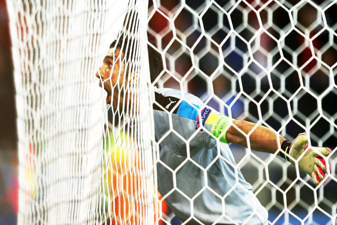 Italy captain Gianluigi Buffon celebrates his team's 2-0 win over Belgium after their Group E match at Stade des Lumieres in Lyon on Monday