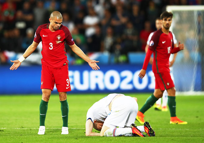 Portugal's Pepe appeals after colliding with Iceland's Jon Dadi Bodvarsson during their Group F match at Stade Geoffroy-Guichard in Saint-Etienne, on Tuesday, June 14