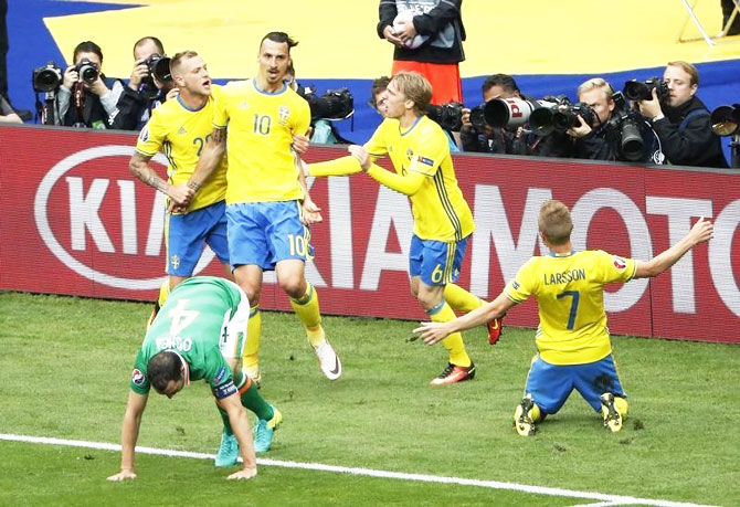 Sweden's John Guidetti, Emil Forsberg and Zlatan Ibrahimovic celebrate after Republic of Ireland's Ciaran Clark scores an own goal and Sweden's first during their Group E match in Saint-Denis near Paris on Monday