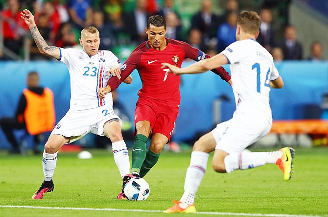 Rediff Sports - Cricket, Indian hockey, Tennis, Football, Chess, Golf - Euro: Debutants Iceland hold Ronaldo's Portugal to shock draw