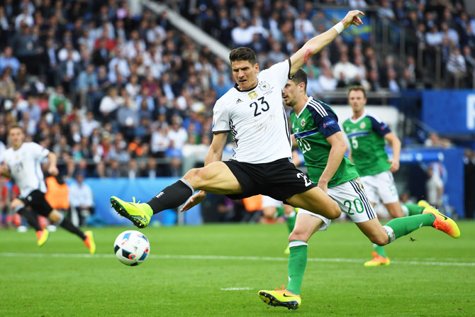 Germany's Mario Gomez stretches for the ball during the Euro 2016 Group C match against Northern Ireland Parc des Princes in Paris, on Tuesday