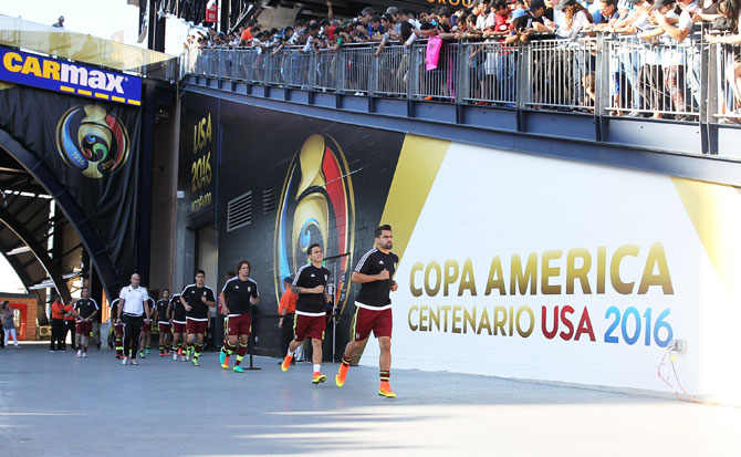 Members of Venezuela enter the field before the 2016 Copa America Centenario quarterfinal match against Argentina at Gillette Stadium in Foxboro, Massachusetts