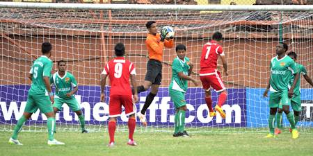 Salgaocar players, in green, defend during a match against Shillong Lajong